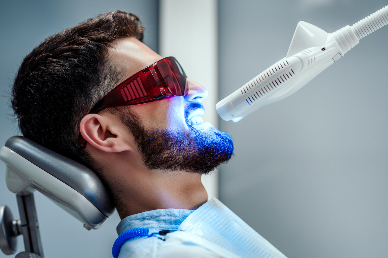 Man in dentist chair undergoing laser dentistry. Is laser dentistry safe?